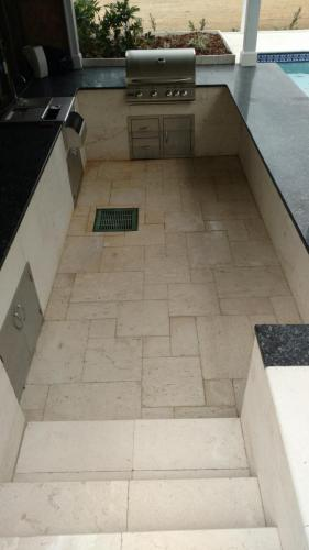 Sunken kitchen w/ Seashell Limestone, Sizzler Grill, Bar Center, Doors and Drawers
